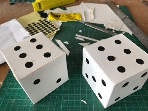 home made dice showing a double 6