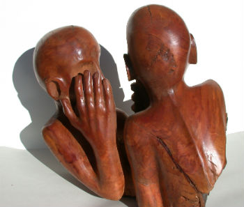 Carving of two people whispering by Peter Heywood
