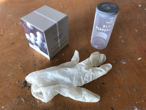A box, cylindical container and latex glove