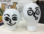 Trying out painting faces on glazed test pieces for ceramics project
